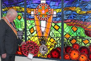 Orange Order grand master Edward Stevenson lays a wreath at the memorial window in Schomberg House