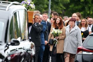 Family and friends of actress Julie Maxwell follow her coffin as it leaves her north Belfast family home for Roselawn Picture by Jonathan Porter/PressEye