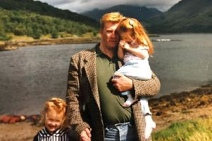 Constable John Graham with two of his three daughters