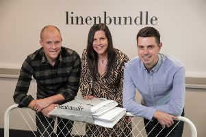 Pictured are Paul Nesbitt (left) and Thomas Glackin (right), Directors at Linen Bundle with Jenna Mairs, Senior Investment Manager at Whiterock Finance