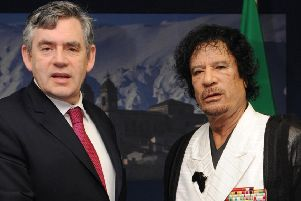 Then prime minister Gordon Brown meeting Col Gaddafi at the G8 Summit in L'Aquilla in 2009