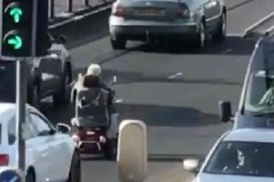 The older gentleman was stopped on the bridge by the P.S.N.I. (Photo/video courtesy of David Mercer)