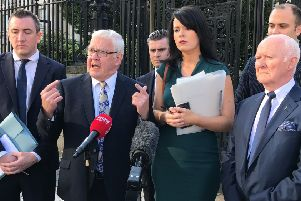 Francis McGuigan (second left) outside of the High Court in Belfast on Friday September 20 2019, where he welcomed a ruling by the Court of Appeal in Belfast that 14 internees, known as the Hooded Men, had a legitimate expectation of a PSNI investigation into their treatment. Photo: Rebecca Black/PA Wire