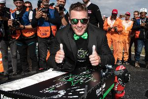 Jonathan Rea donned a Kawasaki-green dickie bow and jacket as he toasted his fifth successive World Superbike title success on Sunday at Magny-Cours in France.