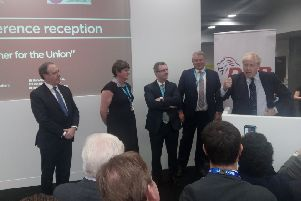 Nigel Dodds MP, Arlene Foster MLA and Sir Jeffrey Donaldson MP listen to the prime minister, Boris Johnson, addressing the DUP drinks reception at the Conservative Party conference on Tuesday October 1 2019