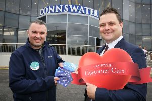 Connswater Shopping Centre manager Mark Rainey rewards David Vance from Lidl with �100 of gift vouchers and a customer care award after his recent act of kindness paying for a customer's shopping who was having difficulty paying. 'Picture by Matt Mackey / Press Eye