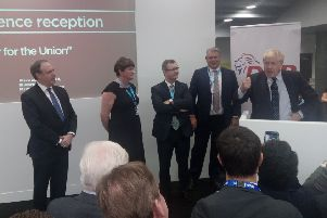 Nigel Dodds MP, Arlene Foster MLA and Sir Jeffrey Donaldson MP listen to the prime minister, Boris Johnson, addressing the DUP drinks reception at the Conservative Party conference on Tuesday October 1. The event was full of patriotic fervour, then hours later Mr Johnson's Brexit plan was unveiled