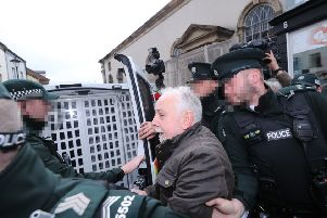 John Downey, who is facing prosecution for the murder of two soldiers in Northern Ireland is taken from Omagh Magistrates' Court in Omagh last Saturday, where he was refused bail due to the judge's assessment that he may be a flight risk. Photo: Nial Carson/PA Wire