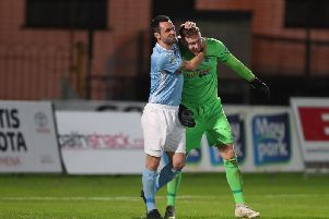 Ballymena United captain Jim Ervin celebrates with goalkeeper Jordan Williamson after their penalty shoot-out win over Crusaders