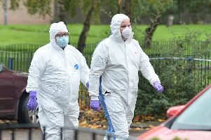 PSNI forensic officers arrive at the scene in east Belfast. (Photo: Pacemaker)