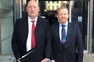 John Sproule and Ken Funston deliver a file to the Attorney General's office calling for a new inquest into the murder of John's brother, Ian.
