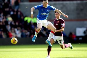 Rangers' Ryan Kent (left) and Heart of Midlothian's Jamie Brandon battle for the ball during the Ladbrokes Scottish Premiership match at Tynecastle Park, Edinburgh. Pic by PA.