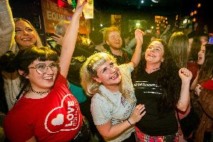 Martha Brown (left, grey t-shirt) with her partner Louise McCullough (right, black t-shirt) and equal marriage supporters at Maverick Bar, Belfast, celebrate the change to abortion and same sex marriage laws in Northern Ireland at 00:01.