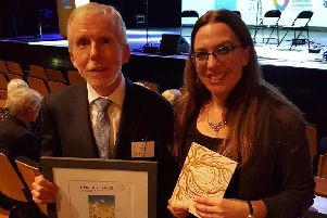 Peter Lant, Education Officer, Hill of the O'Neill and Ranfurly House with Myra Zepf, Children's Writing Fellow for Northern Ireland (2017-19) at the Ulster Architectural Heritage Awards, with the award for the 'Best Contribution to a Heritage Project by Young People' on behalf of the Heartland project.