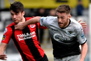 Institute's Niall Grace fired home their equaliser against Glentoran.