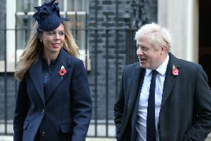 Boris Johnson, with partner Carrie Symonds in Downing Street yesterday, published his Withdrawal Deal last month