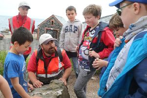 National Trust Visitor Experience Officer Laurence Ghisoiu with members of the Ballintoy Rockhound Club