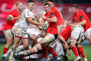 Ulsters John Cooney clears his lines against Munster