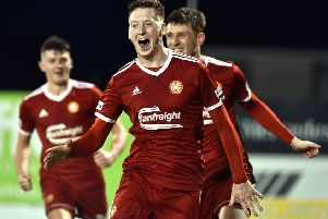 Conal McGrandles celebrates Portadown's winning goal against Loughgall. Pic by Tony Hendron.