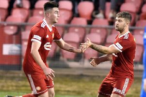 Aaron Duke (left) enjoys his successful substitute appearance for Portadown against Loughgall. Pic by Tony Hendron.