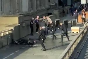 Police and members of the public tackle a knife wielding terrorist on London Bridge