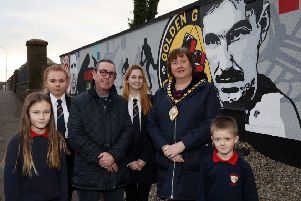 Dave 'Boy' McAuley and the Mayor of Mid and East Antrim, Cllr Maureen Morrow, alongside pupils from Moyle Primary School and Larne High School at the new mural.