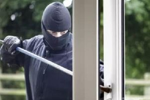 The gangs forced their way into the homes of two pensioners, said the PSNI