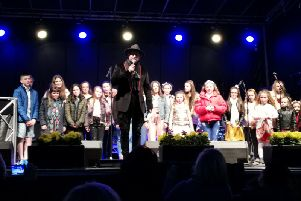 The choir on stage with Brian.