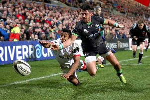 Ulster's Robert Baloucoune and Tiernan O'Halloran of Connacht attempt to ground the ball