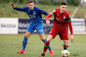 Hanover's Matthew Brown up against Ryan Curran of Cliftonville