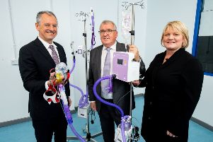 Pictured are Kevin Holland, CEO, Invest Northern Ireland with John Armstrong, Executive Chair, Armstrong Medical and Dawn Hart, Financial Director, Armstrong Medical