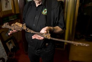 Kevin Carson curator of  Roddy McCorley Society living history museum in Belfast holds the mangled metal frame of an L1A1 Self-Loading Rifle. The gun was found by Johnny Brennan on the Omeath foreshore approximately a year after the Narrow Water IRA attack that killed 18 members of the parachute regiment. PA Photo. Picture date: Tuesday December 31, 2019. See PA story ULSTER Museum. Photo credit should read: Liam McBurney/PA Wire