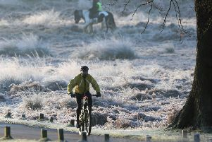 A cyclist rides through a frost-covered Richmond Park in south west London where overnight temperatures dipped to -3C. PA Photo. Picture date: Sunday January 19, 2020.  Photo: Martin Keene/PA Wire