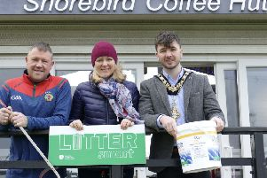 The Mayor of Causeway Coast and Glens Borough Council Councillor Sean Bateson pictured with James Delaney from The Shorebird Caf� in Ballycastle and Environmental Resources Officer Janice Dunlop at the launch of the Beach Bucket Challenge