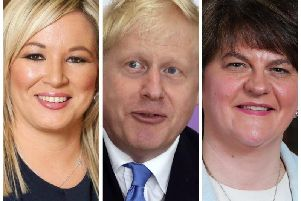 Deputy First Minister and Sinn Fein Vice-President, Michelle O'Neill (left), Prime Minister, Boris Johnson and First Minister and leader of the DUP, Arlene Foster.