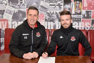 Crusaders manager Stephen Baxter welcomes new signing Cameron Dummigan to Seaview