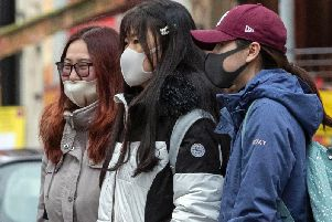Members of the Chinese community in Manchester wearing face masks. The Government's Cobra committee is meeting in Downing Street to discuss the threat to the UK from coronavirus. (Photo: Peter Byrne/PA Wire)