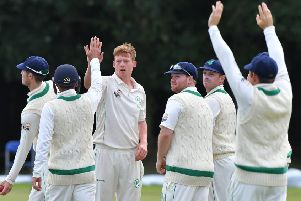 Craig Young of Ireland takes the first two Hong Kong wickets.
