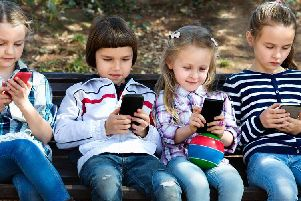 Kids on mobile phones