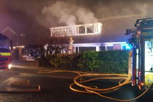 Firefighters tackle a blaze at a house in Sharonmore Avenue, Carnmoney on Saturday evening. Pic by Alan Harper