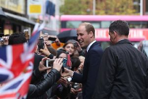 BELFAST, NORTHERN IRELAND - OCTOBER 04: Prince William, Duke of Cambridge greets well wishers after his visit  to Inspire, a charity and social enterprise which focuses on promoting wellbeing for all across Ireland, during His Royal Highness' one day visit to the province on October 4, 2017 in Belfast, Northern Ireland. His Royal Highness is on a one day visit to the province. (Photo by Niall Carson - WPA Pool/Getty Images)
