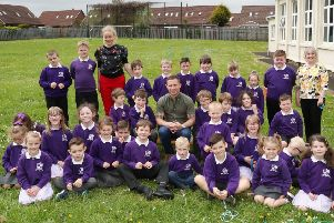 Carl Frampton pictured with staff and students at Mallusk Integrated Primary.