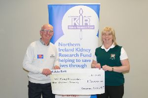Arlene Ferguson, Lady Captain of Greenacres Ladies' Golf Club presenting her charity cheque to John Brown, Chairman of NI Kidney Research Fund.