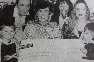Olivia and Marjorie Lynn ran a jewellery sale and raised �190.70 for Greendale Nursery. They presented their cheque to staff members Grace and Linda and children.1997
