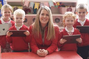 Karen Irwin encouraging pupils to explore the use of technology.
