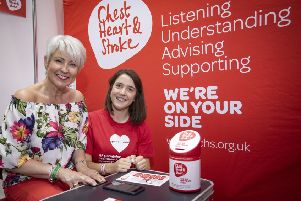 Pamela Ballantine takes the AF test with Hannah Williamson, senior health and wellbeing officer, Northern Ireland Chest Heart and Stroke.
