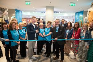 Neale Kirk, ISE Regional lead and Brendan Wallace, store manager, cutting the ribbon at the official opening of the store.
