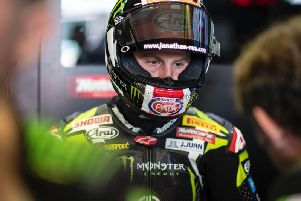 Jonathan Rea suffered a crash in Sunday's Superpole race at Misano before re-joining the race to finish fifth.