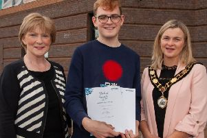 Daniel pictured with Professor Terri Scott, Principal and Chief Executive of Northern Regional College and the Deputy Mayor of Antrim and Newtownabbey Borough Council Cllr Anne Marie Logue.