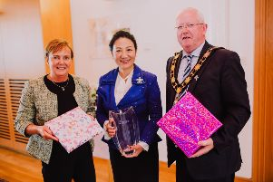Mayor of Antrim and Newtownabbey, Alderman John Smyth is joined by Chief Executive of Antrim and Newtownabbey, Jacqui Dixon to present gifts to Chinese Consul General, Madam Zhang in Mossley Mill.